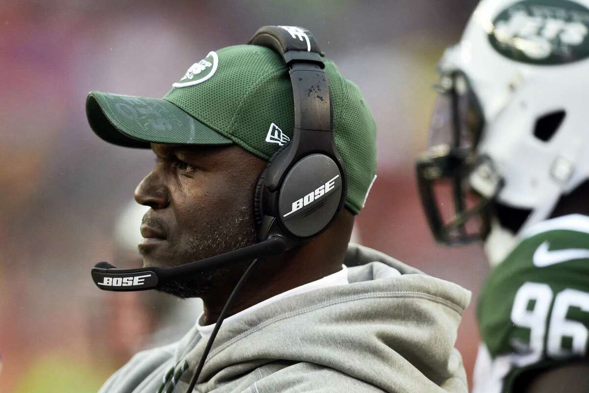 In this file photo, New York Jets coach Todd Bowles stands on the sideline during the team's NFL football game against the Cleveland Browns in Cleveland. Bowles will be with the team for its game today with the Patriots.