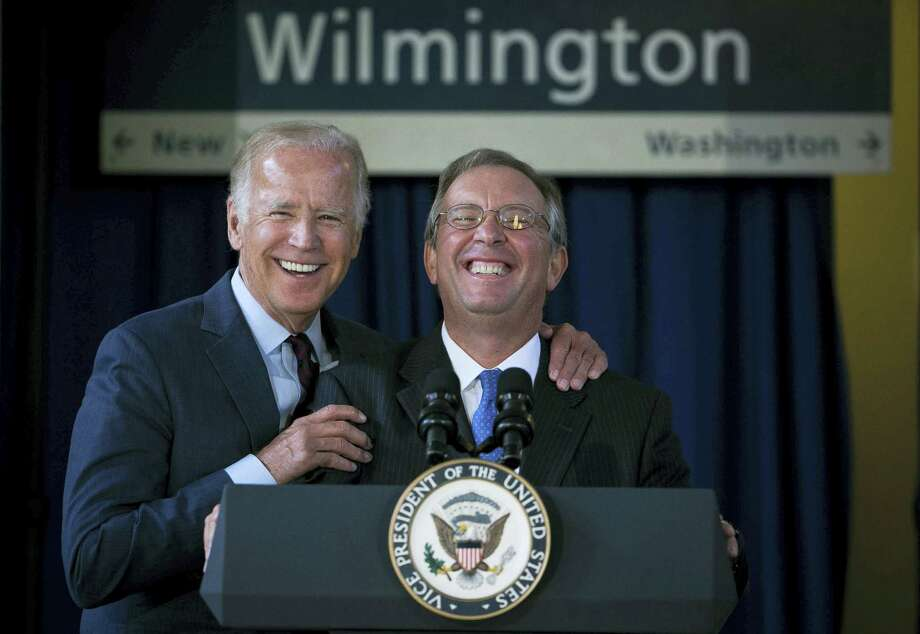 Anthony Coscia, right, Chairman of the Board for Amtrak, and Vice President Joe Biden enjoy a light moment at the Joseph R. Biden Jr. Railroad Station in Wilmington, Del., Friday. Photo: Suchat Pederson — The Wilmington News-Journal Via AP  / The Wilmington News-Journal