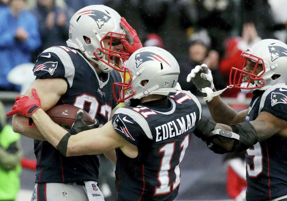Patriots tight end Matt Lengel, left, celebrates his touchdown catch with Julian Edelman, center, and Malcolm Mitchell during the first half Saturday. Photo: Charles Krupa — The Associated Press  / Copyright 2016 The Associated Press. All rights reserved.