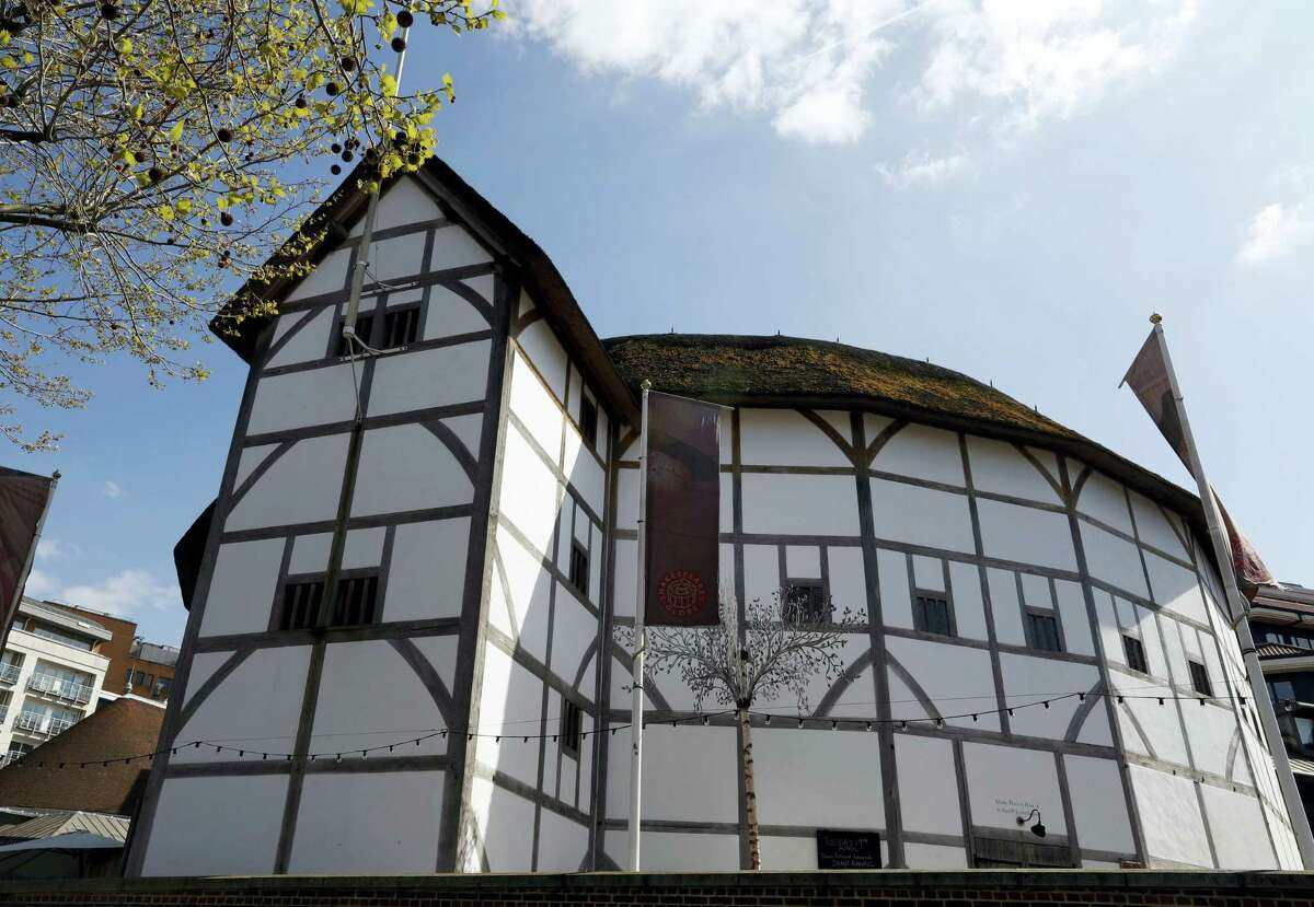 """A view of The Globe Theatre, nestled alongside contemporary buildings on the banks of the River Thames in London, in this photo dated Tuesday, April 19, 2016. The 400th anniversary of the playwright's death on April 23 is being marked across Britain with parades, church services and, of course, stage performances. Shakespeare wrote """"the play's the thing,"""" and today all the world may be contained on stage at the Globe Theatre."""