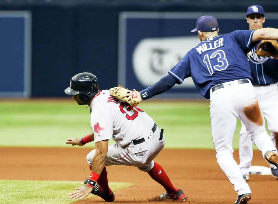Rays shortstop Brad Miller tags Chris Young during a rundown in the sixth inning on Thursday. Photo: Will Vragovic — Tampa Bay Times Via AP  / Tampa Bay Times