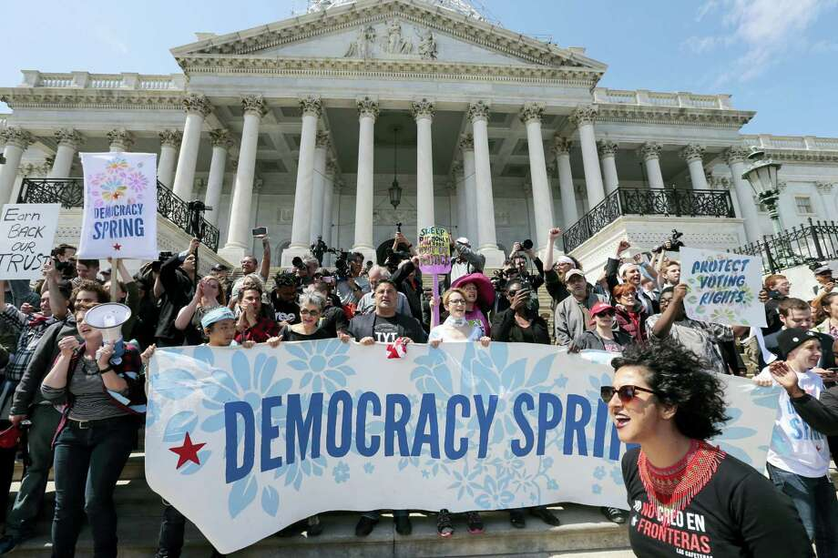 Alejandra Pablos of Arizona, lower right, leads a chant as voting rights reform demonstrators stage a sit-in at the Capitol in Washington on April 11, urging lawmakers to take money out of the political process. Photo: THe Associated Press  / AP