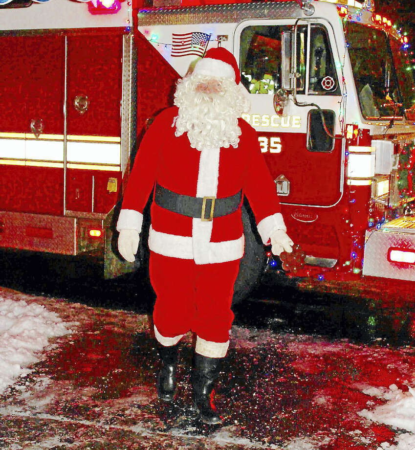 Santa Claus makes an appearance Saturday as part of Middletown's South Fire District Adopt-A-Family event at the Elks Lodge. Photo: Contributed Photo
