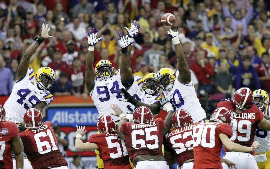 In this file photo, Alabama's Jeremy Shelley (90) has a field goal blocked by SEC rival LSU. Photo: The Associated Press File Photo  / Copyright 2016 The Associated Press. All rights reserved. This material may not be published, broadcast, rewritten or redistribu