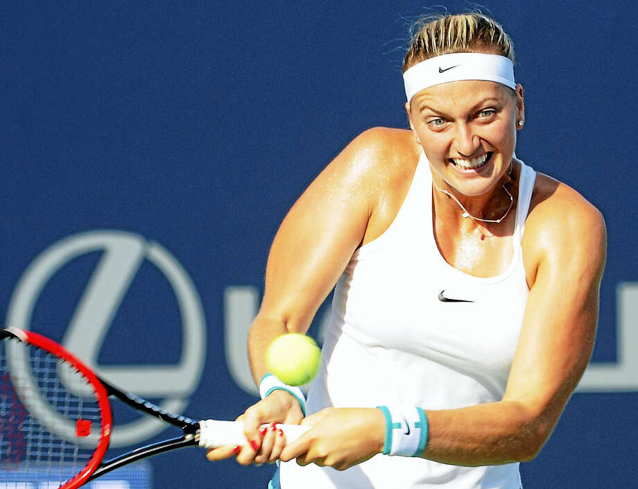 Petra Kvitova hits a backhand return to Ekaterina Makarova in their quarterfinal match at the Connecticut Open on Thursday. Photo: Bob Child — For The Register
