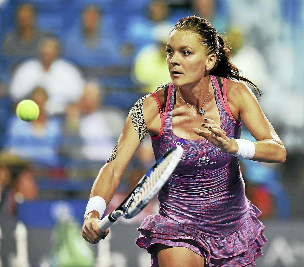Agnieszka Radwanska defeated Belgium's Kristen Flipkens in a quarterfinal match on Thursday.
