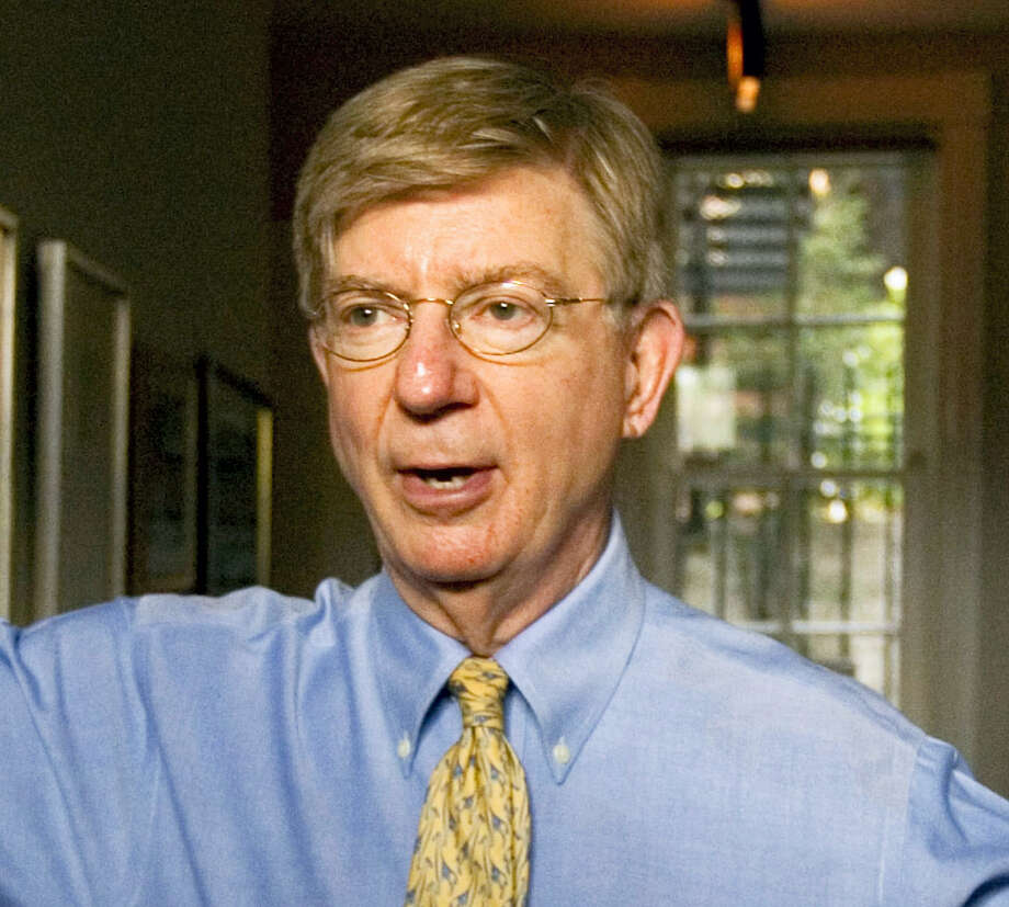 "Conservative columnist and pundit George Will appears in this office in the Georgetown section of Washington in 2008. Will has parted ways with the Republican Party, changing his voter registration to ""unaffiliated"" because of the GOP's support of Donald Trump. Photo: AP Photo — J. Scott Applewhite, File / AP"