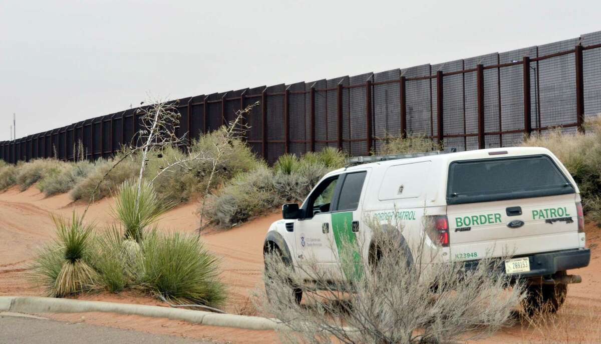 A U.S. Border Patrol vehicle drives next to a U.S.-Mexico border fence in the booming New Mexico town of Santa Teresa.