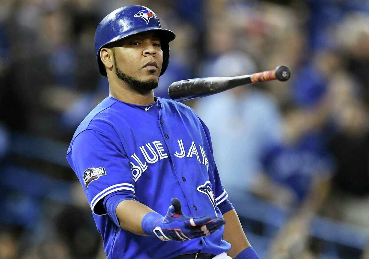 FILE - In this Wednesday, Oct. 19, 2016 file photo, Toronto Blue Jays' Edwin Encarnacion flips his bat after a foul ball against the Cleveland Indians during fourth inning in Game 5 of baseball's American League Championship Series in Toronto. A person familiar with the negotiations says free agent slugger Edwin Encarnacion has reached agreement on a contract with the Cleveland Indians. The sides reached a deal on Thursday night, Dec. 22, 2016 pending a physical. Encarnacion hit 42 homers and drove in 127 runs last season. (Frank Gunn/The Canadian Press via AP, File)