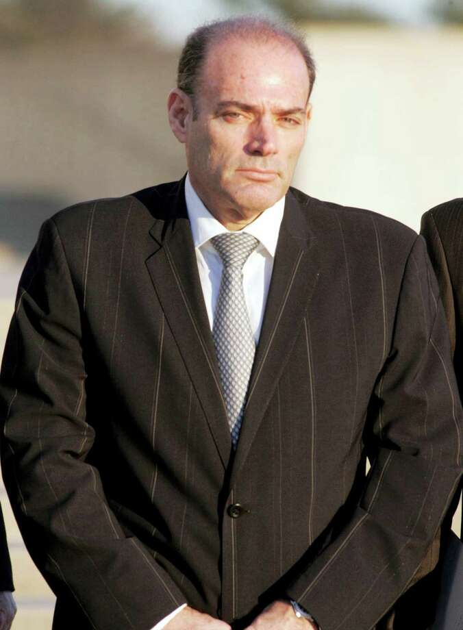 David Brooks leaves the federal courthouse in Central Islip, N.Y. in 2008. Brooks, the founder of America's leading supplier of body armor to the U.S. military, died Thursday in prison while serving a 17-year sentence for running a massive stock fraud scheme. He was 61.  Newsday, Howard Schnapp — AP File Photo Photo: AP / AP2008