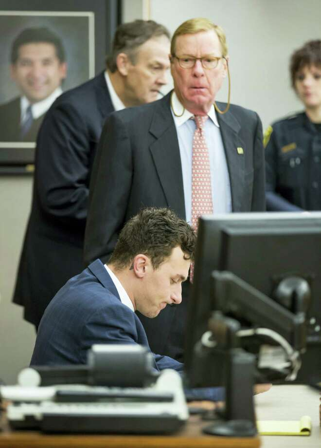 Former Cleveland Browns quarterback Johnny Manziel sits at the defense table as his attorney Bob Hinton, center, looks on during a hearing, in Dallas. Photo: The Associated Press File Photo  / Pool The Dallas Morning News