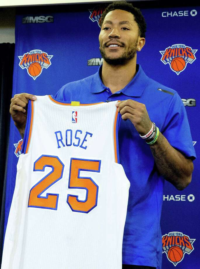 Derrick Rose poses for photographers with his Knicks jersey during a news conference at Madison Square Garden on Friday. Photo: Mary Altaffer — The Associated Press  / Copyright 2016 The Associated Press. All rights reserved. This material may not be published, broadcast, rewritten or redistribu