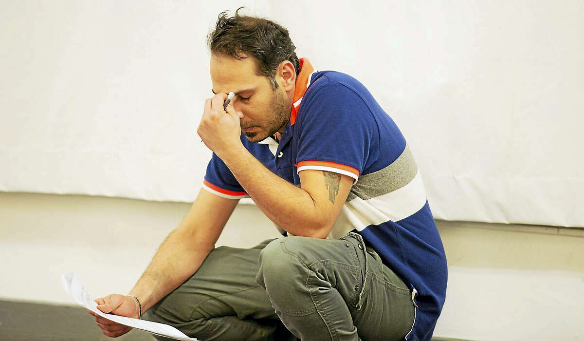 """Iraqi refugee Ali Al Saadi working on his lines for """"Voices From the Long War."""""""