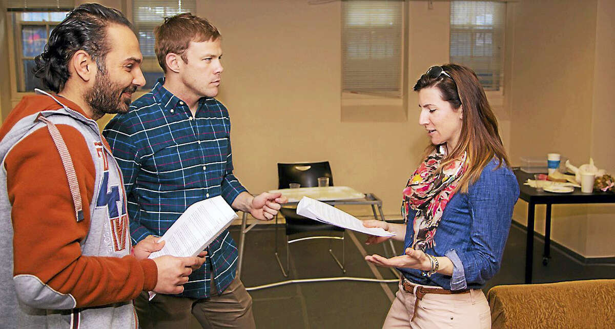 """From left, Ali Al Saadi, executive producer Tom Berry and Liz Verardo work on a scene for """"Voices From the Long War."""""""