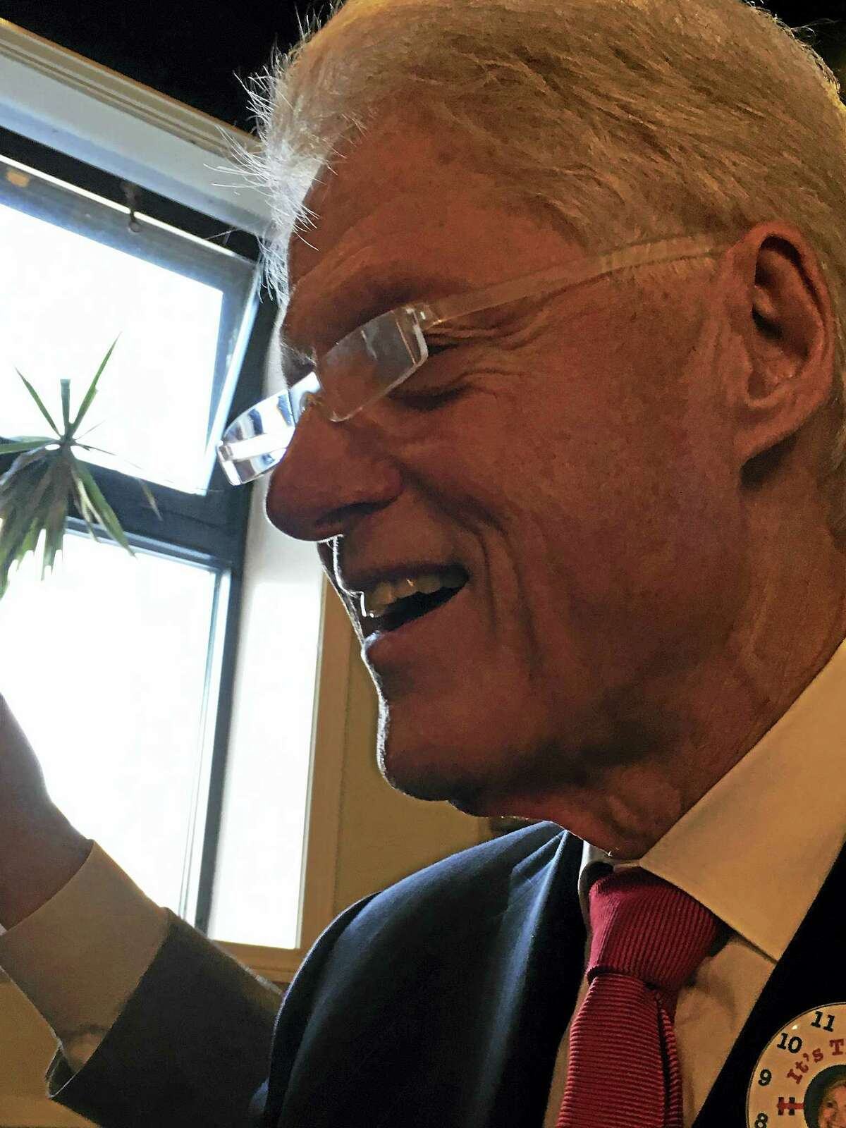 Former president Bill Clinton Thursday at Pepe's in New Haven.