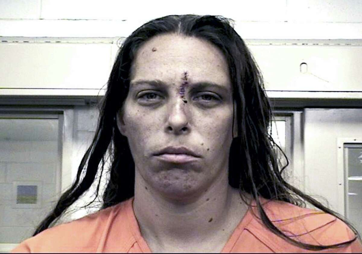 """This Aug. 25, 2016, booking photo provided by the Metropolitan Detention Center shows Michelle Martens. New Mexico Gov. Susana Martinez says what happened to the little girl """"is unspeakable and justice should come down like a hammer"""" on whoever is responsible. Officer Tanner Tixier said in a news release Wednesday, Aug. 24, that charges are being filed against Martens, Fabian Gonzales, and Jessica Kelley."""