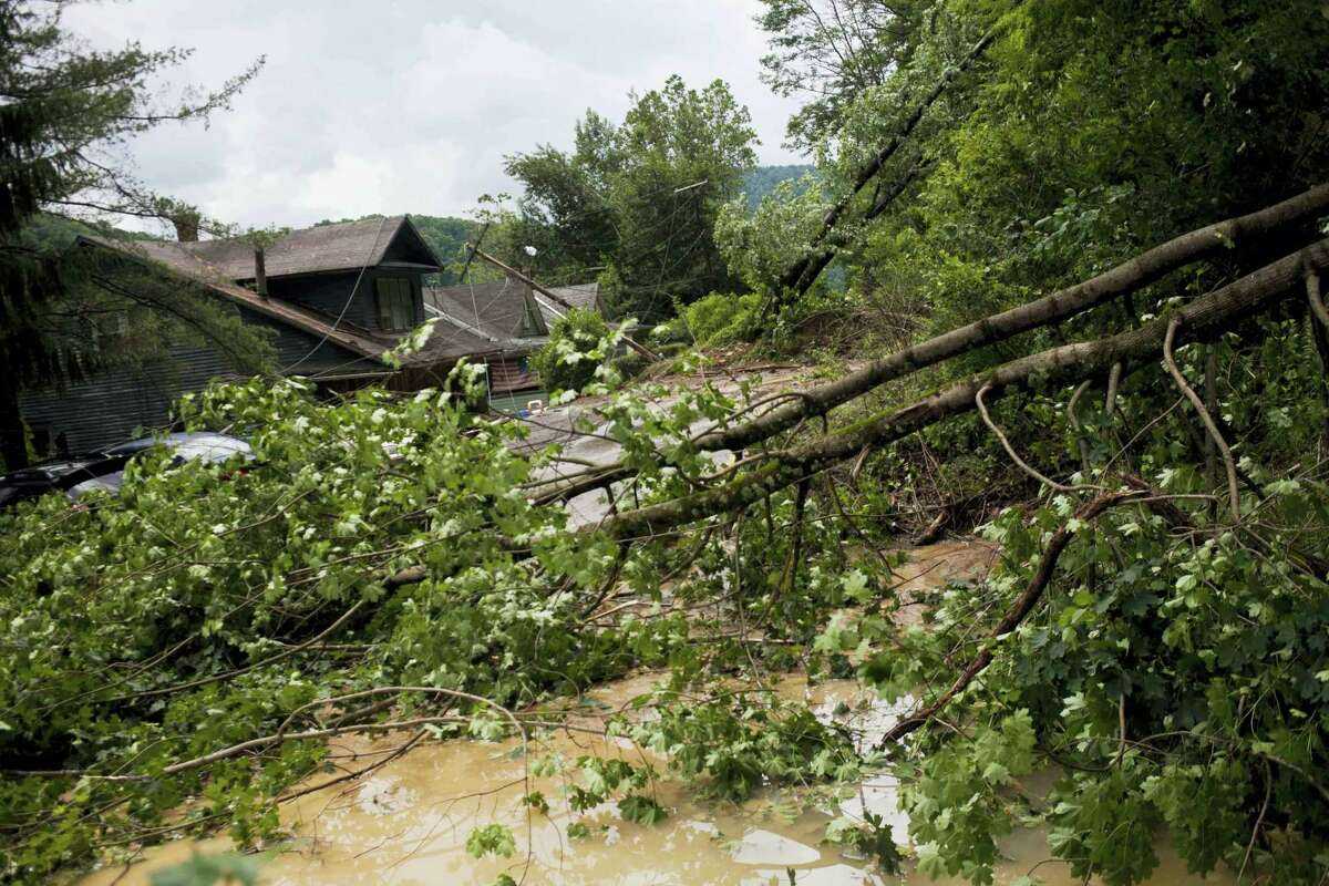 Rock, mud, trees, downed power lines and other debris litter the road on Main Street leading into Richwood, W.Va. after severe flooding and multiple rockslides on Friday.