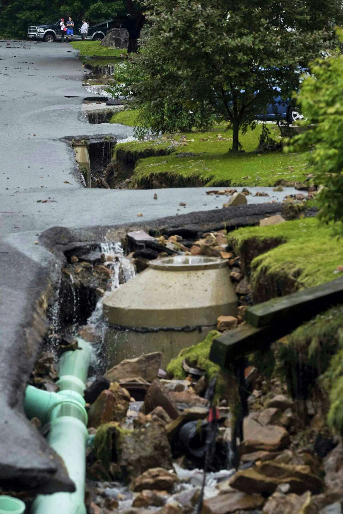Exposed piping of city water and sewers systems lay bare after being exposed by the removal of front lawns and large portions of asphalt along Oakford Avenue by severe flood waters in Richwood, W.Va. on Friday.
