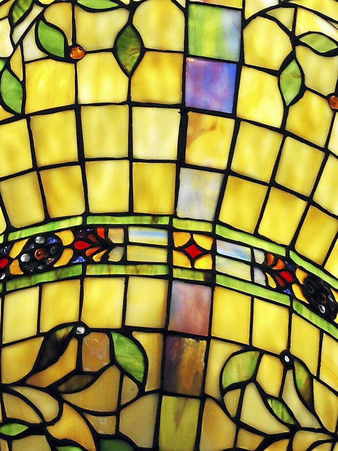 A colorful stained-glass chandelier hangs in one of the rooms. Photo: Eileen McNamara Photo