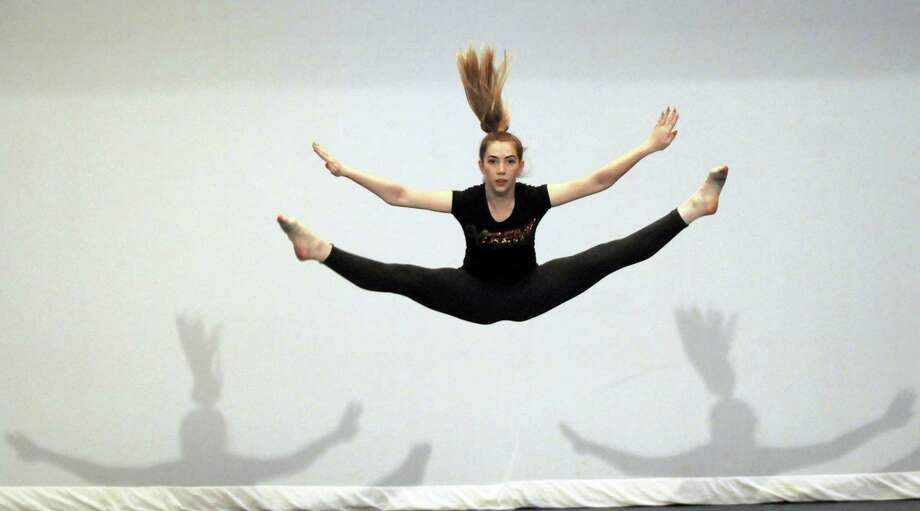 In this Wednesday, June 8, 2016, photo, Lexy Blair, Extreme Dance, performs an arabesque during rehearsal for Extreme Dance Spring Recital at the Extreme Dance Studios in Martinsburg, W.Va. The dance is for cancer survivors. Photo: Ron Agnir/The Journal Via AP   / RAgnir