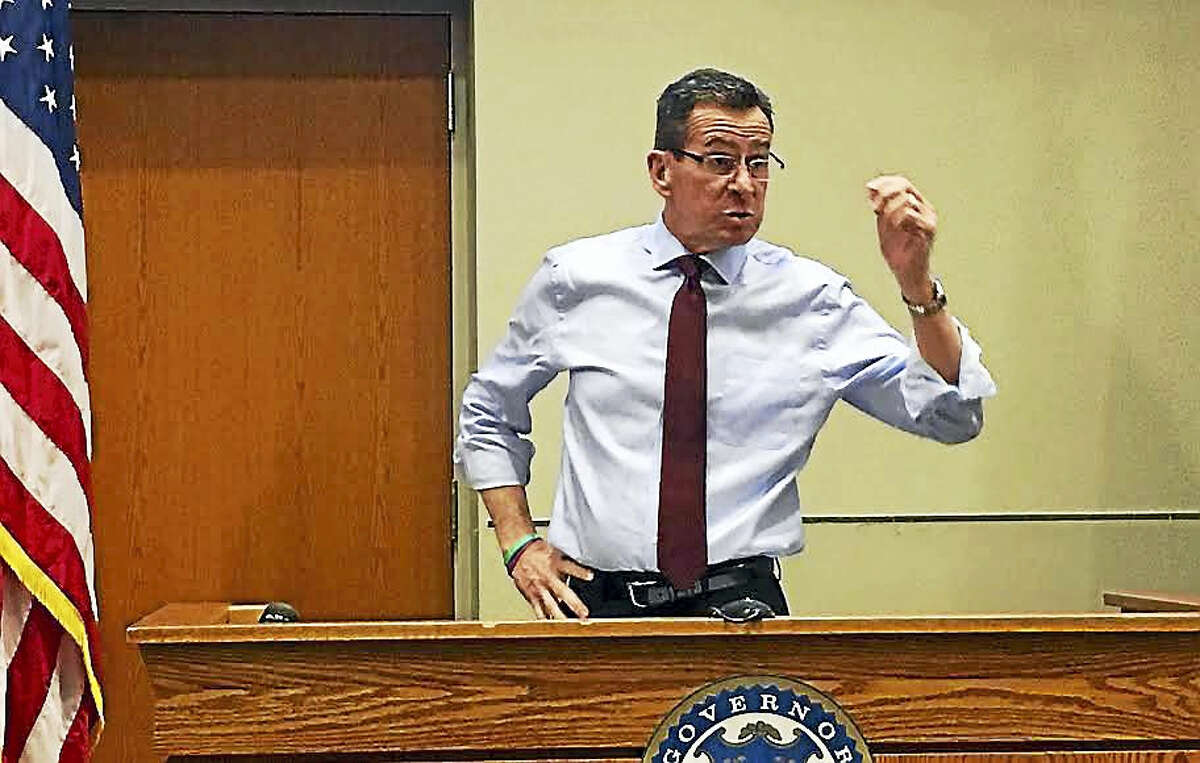 Gov. Dannel P. Malloy speaks at a town forum in Middletown's Council Chambers Tuesday, addressing his proposed budget reductions and how the state is adapting to the changing economy.