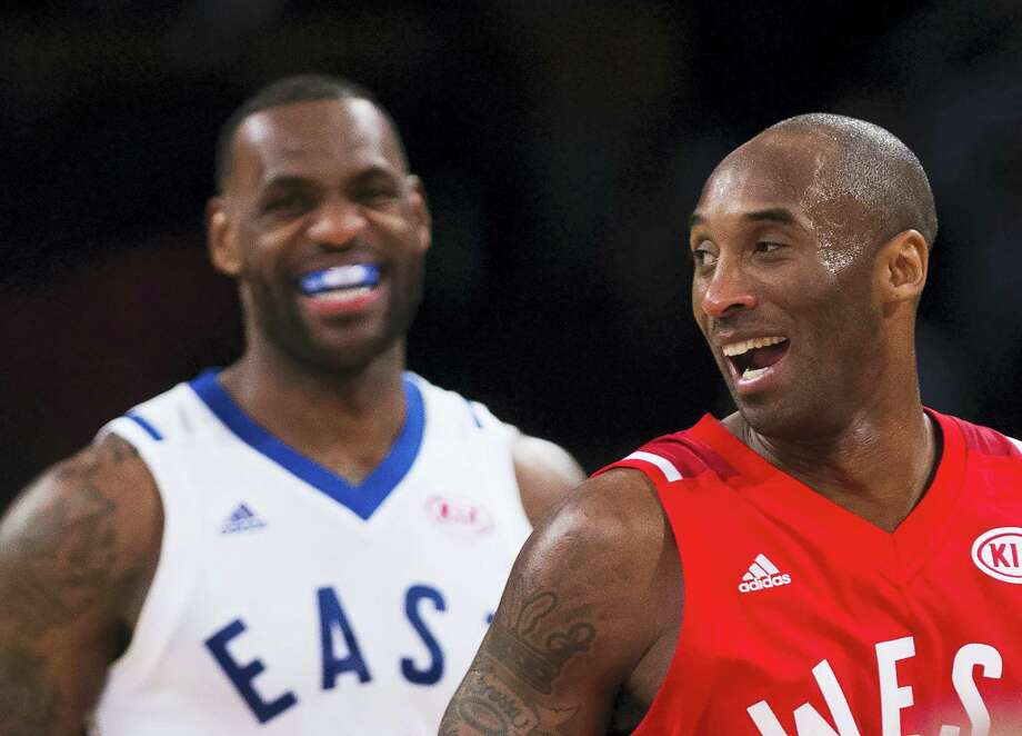 Western Conference's Kobe Bryant, of the Los Angeles Lakers, (24) and Eastern Conference's LeBron James, of the Cleveland Cavaliers, (23) laugh during second half NBA All-Star Game basketball action in Toronto on Sunday, Feb. 14, 2016. (Mark Blinch/The Canadian Press via AP) MANDATORY CREDIT Photo: AP / The Canadian Press