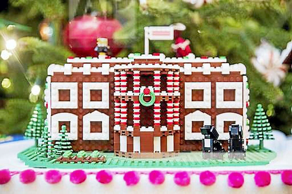 In this Tuesday, Nov. 29, 2016, file photo a LEGO model of the White House, one of fifty-six LEGO gingerbread houses, one for each state and territory, is displayed in the trees in the State Dinning Room at the White House during a preview of the 2016 holiday decor, in Washington. White House holiday displays were created this year by Lego's master builders, a team of seven at the company's US headquarters in Enfield, Conn., who devote hours and tens of thousands of toy bricks to projects that go on display around the world.