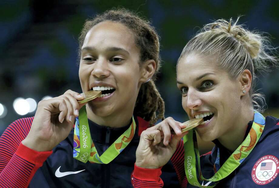 United States' Brittney Griner, left, and Elena Delle Donne, right, celebrate with their gold medals after their win in a women's basketball game against Spain at the 2016 Summer Olympics in Rio de Janeiro, Brazil on Aug. 20, 2016. Photo: AP Photo/Eric Gay  / Copyright 2016 The Associated Press. All rights reserved. This material may not be published, broadcast, rewritten or redistribu