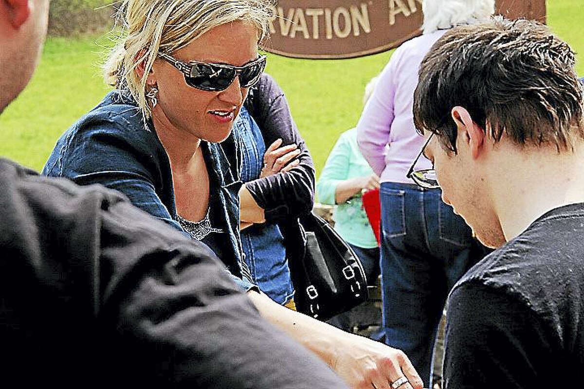 Kathleen Schassler — The Middletown Press City of Middletown Environmental Planning Specialist Michelle Ford joins hikers at Guida Farm Conservation Area to celebrate Earth Day on Friday.