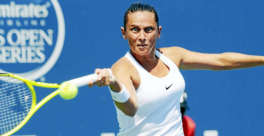 Roberta Vinci hits a forehand return in her match with Ana Konjuh at the Connecticut Open Wednesday. Photo: Bob Child — For The Register