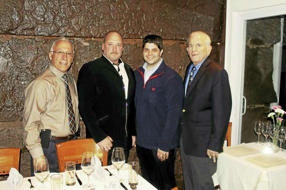 Bread & Water restaurant, located at the site of the 1850s jailhouse on 51 Warwick Street in Middletown, held an opening reception on Feb. 10. Shown are Middletown Common Councilman Phil Pessina, building owner Lee Godburn, Middletown Mayor Dan Drew and Chamber President Larry McHugh. Photo: Courtesy Photo
