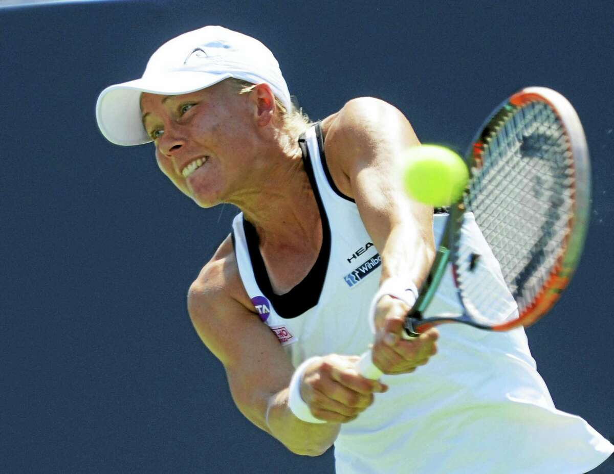 Johanna Larsson hits a backhand return to Shelby Rogers at the Connecticut Open Wednesday.