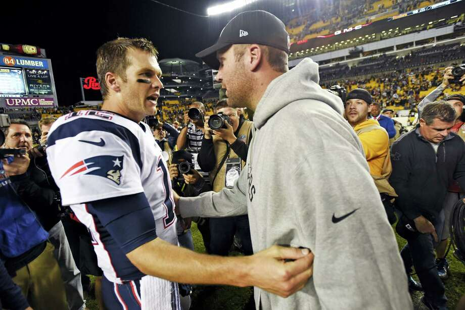 Steelers quarterback Ben Roethlisberger, right, and New England Patriots quarterback Tom Brady, left, visit on the field after their game in Pittsburgh. Photo: The Associated Press File Photo   / FR87040 AP