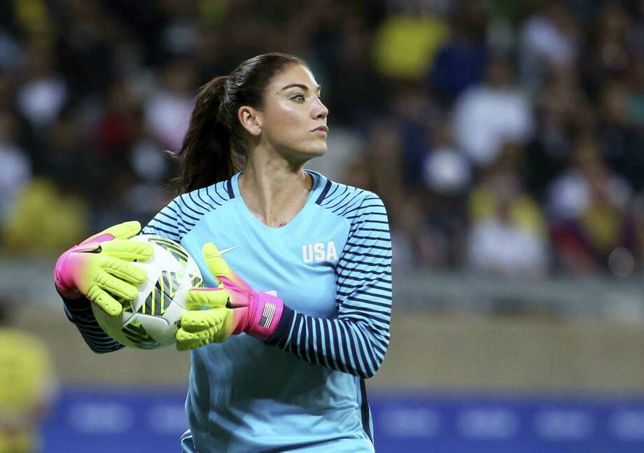"In this Aug. 3 file photo, U.S. goalkeeper Hope Solo takes the ball during a women's Olympic soccer tournament match against New Zealand. Solo has been suspended form the team for six months for what U.S. Soccer termed conduct ""counter to the organization's principles."" The suspension is effective immediately. Photo: EUGENIO SAVIO - THE ASSOCIATED PRESS  / AP"