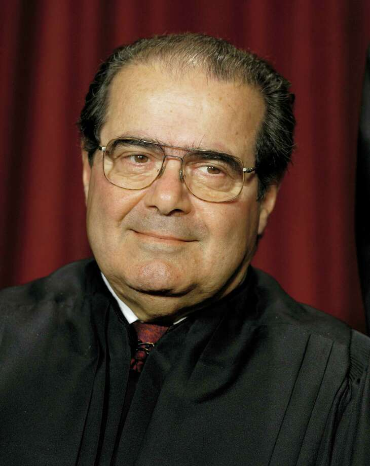 In this Oct. 31, 2005 photo, Associate Justice Antonin Scalia joins the members of the Supreme Court for photos during a group portrait session, at the Supreme Court Building in Washington. On Feb. 13, 2016, the U.S. Marshals Service confirmed that Scalia has died at the age of 79. Photo: AP Photo/J. Scott Applewhite  / AP