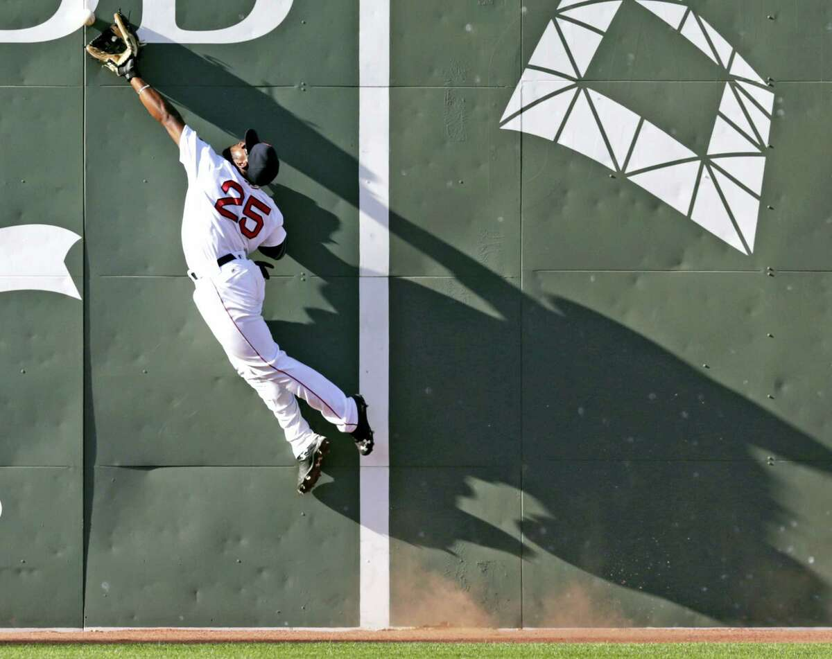 Boston centerfielder Jackie Bradley Jr. stretches but fails to make the catch on an RBI double by Tampa Bay Rays' Steven Souza Jr. during the eighth inning Thursday. Tampa defeated Boston 12-8.