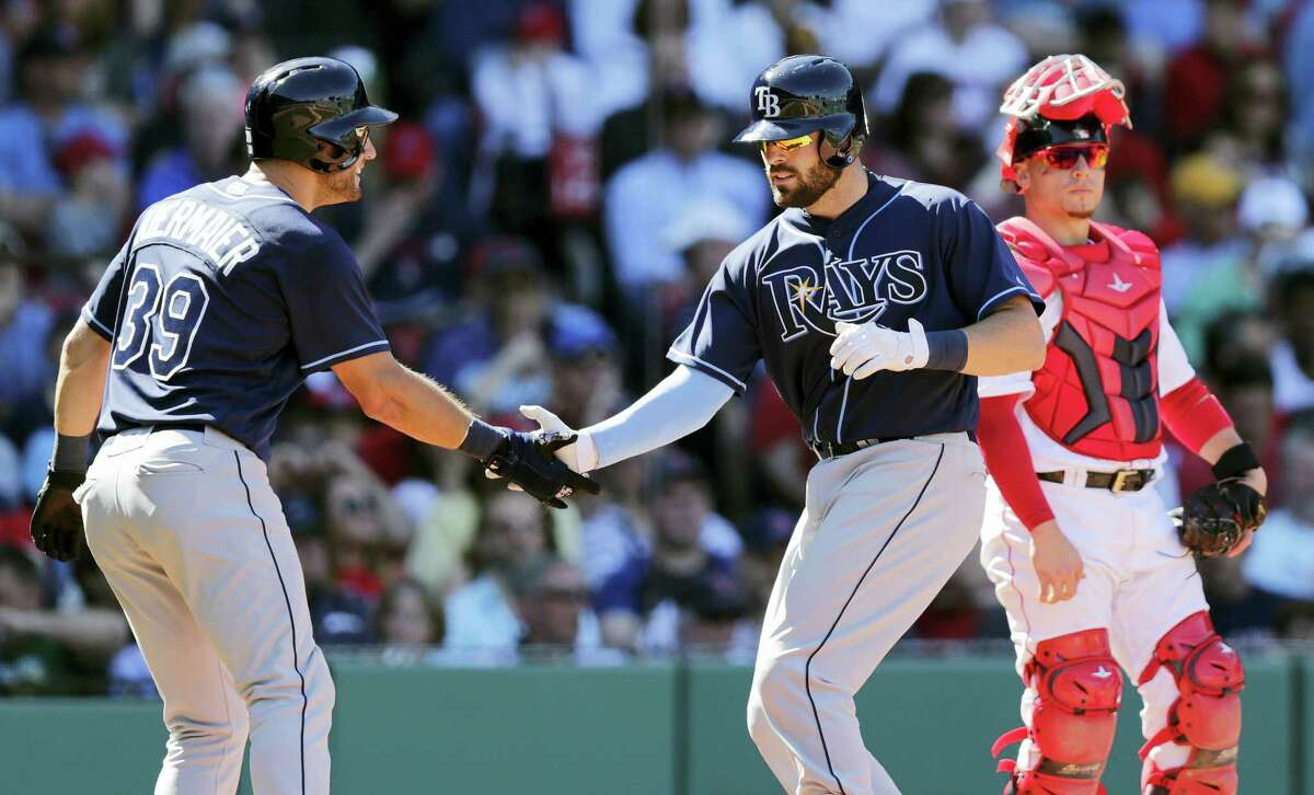 Tampa Bay Rays' catcher and New Canaan native Curt Casali is congratulated by Kevin Kiermaier after his two-run home run during the fourth inning At right is Boston Red Sox catcher Christian Vazquez.