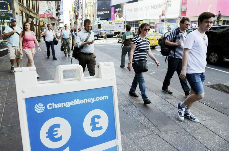 A signboard indicates that euros and pounds can be exchanged at a money exchange in New York Friday. Britain voted to leave the European Union after a bitterly divisive referendum campaign, sending global markets plunging. Photo: ASSOCIATED PRESS  / Copyright 2016 The Associated Press. All rights reserved. This material may not be published, broadcast, rewritten or redistribu
