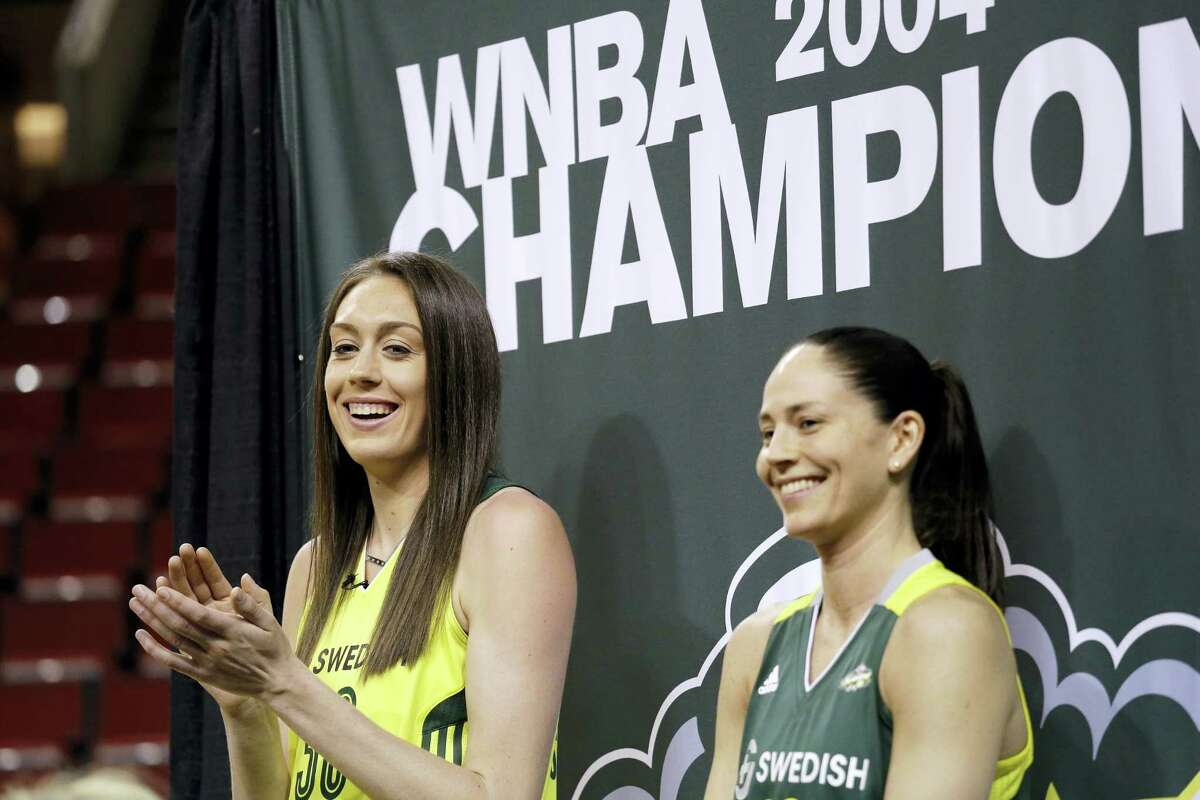Seattle Storm's Breanna Stewart, left, and Sue Bird smile during a news conference Thursday in Seattle. The Seattle Storm unveiled No. 1 pick Stewart, alongside former No. 1 pick and new teammate Bird. Both were former UConn All-American standouts.