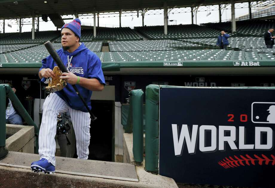 Kyle Schwarber walks out to the field to work out Thursday at Wrigley Field in Chicago. Photo: Charles Rex Arbogast — The Associated Press  / Copyright 2016 The Associated Press. All rights reserved.