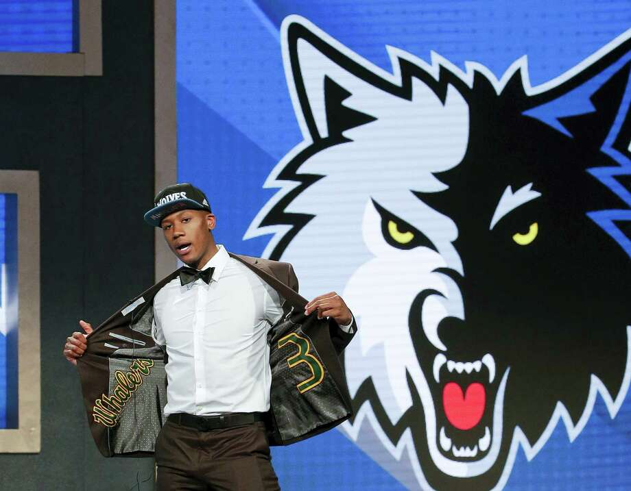 Kris Dunn reacts as he steps up on stage after being selected fifth overall by the Minnesota Timberwolves during the NBA draft Thursday in New York. Photo: Frank Franklin II — The Associated Press  / AP
