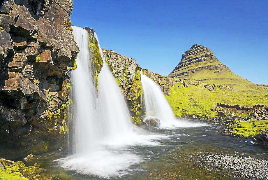 CONTRIBUTED PHOTO  WILD ICELAND  A free opening reception for an exhibit of Iceland's geography by photographer Fred Rosenthal will be held 3-6 p.m. Oct. 30 at the Willoughby Wallace Memorial Library, 146 Thimble Islands Road, Branford. The show will end Nov. 22.  Rosenthal's exhibit includes moss-covered lava fields, mountains separated by fjords, glaciers, rivers, waterfalls, free-roaming sheep and horses. It shows lupine fields, old turf-roofed farmhouses and blue icebergs. Jan Tussing will also be exhibiting her paintings at this show. Photo: CREDIT HERE