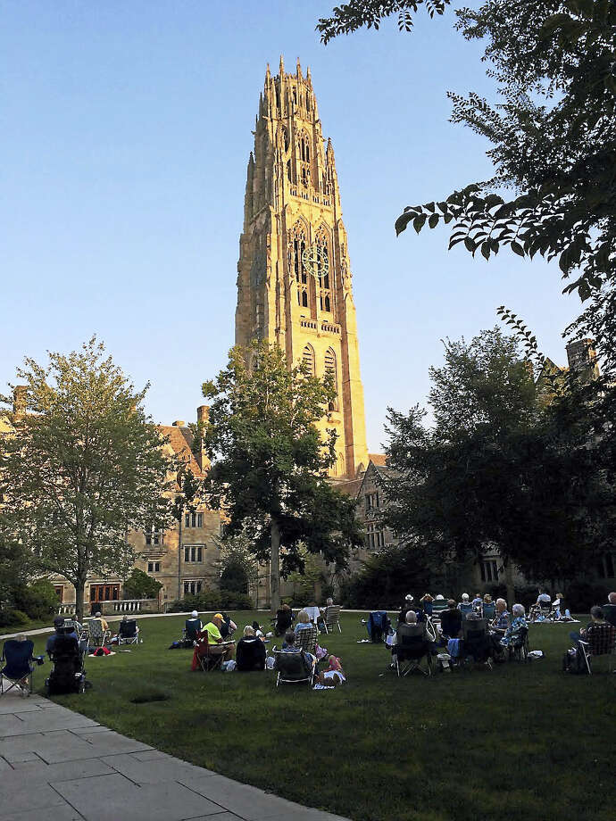 Lounging in Branford Courtyard at Yale during a carillon concert. Photo: Contributed