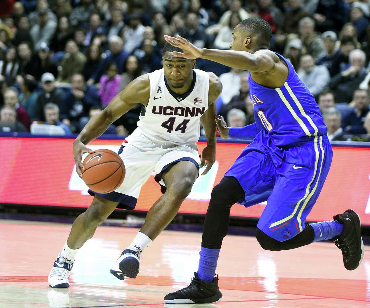 UConn's Rodney Purvis (44) drives past Tulsa's James Woodard (10) during the first half Saturday in Storrs.