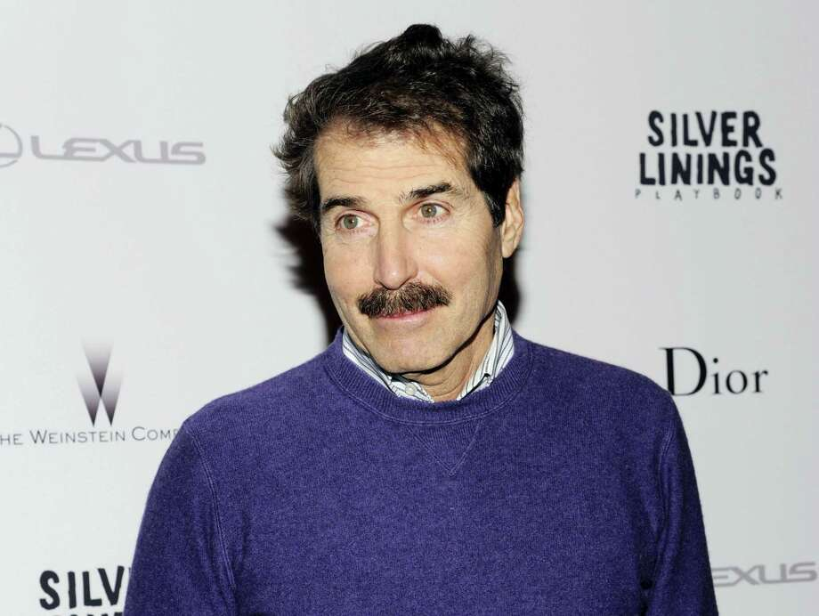 """In this Nov. 11, 2012, file photo, John Stossel attends a special screening of """"Silver Linings Playbook"""" in New York. Stossel says he is being treated for lung cancer. In a commentary posted on the Fox News website Wednesday, Stossel writes that his doctors have told him his cancer was """"caught early"""" and that he'll be """"fine."""" He says one-fifth of a lung was removed, but says he was told that soon he would """"barely notice"""" the loss. Photo: Photo By Evan Agostini/Invision/AP, File   / Invision"""