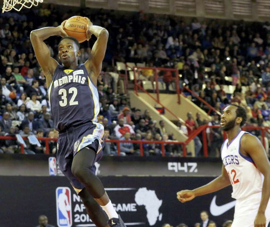 In this Aug. 1, 2015 photo, Team World's Jeff Green of Memphis Grizzlies, left, goes up for a shot as Team Africa's Luc Mbah a Moute from Cameroon looks on during the NBA Africa Game at Ellis Park Arena in Johannesburg, South Africa. The NBA will open an academy in Africa in 2017, its latest move to unearth talent from outside the United States and extend the league's reach into new territories. Photo: AP Photo/Themba Hadebe, File  / Copyright 2016 The Associated Press. All rights reserved. This material may not be published, broadcast, rewritten or redistribu