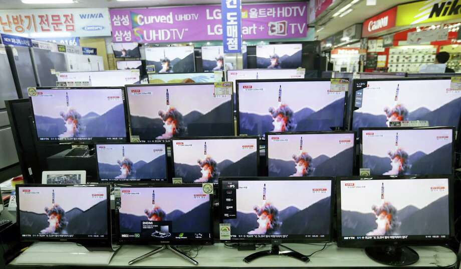 TV screens show file footage of a similar North Korea's ballistic missile that North Korea claimed to have launched from underwater at the Yongsan Electronic store in Seoul, South Korea, Wednesday, Aug. 24, 2016. A North Korean ballistic missile fired from a submarine Wednesday flew about 500 kilometers (310 miles) in the longest flight by that type of weapon, Seoul officials said, a range that can place much of South Korea within its striking distance. Photo: AP Photo/Ahn Young-joon   / Copyright 2016 The Associated Press. All rights reserved. This material may not be published, broadcast, rewritten or redistribu