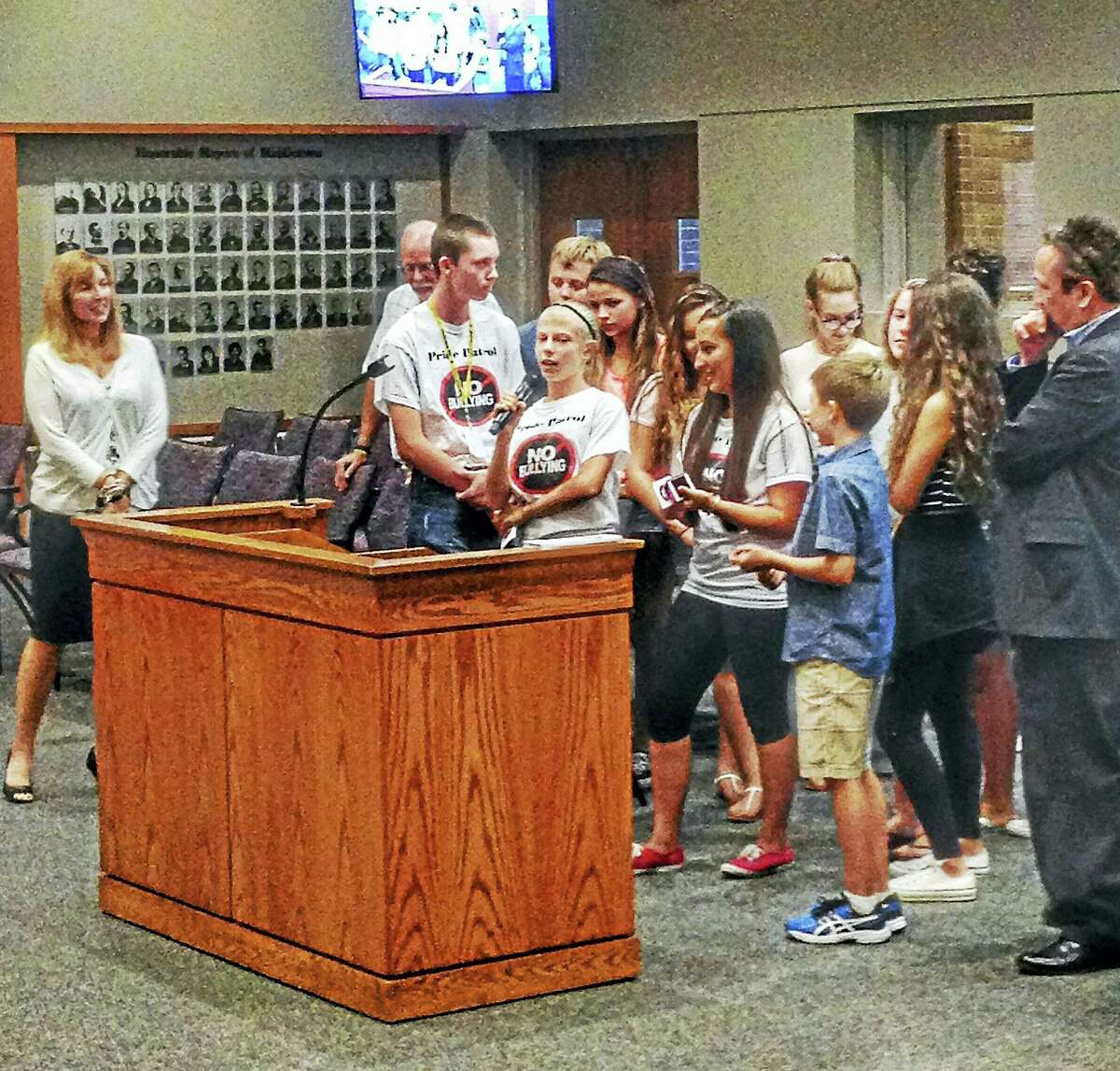 Ram Pride Patrol alumnus celebrated a glow stick ceremony with the city's board of education Tuesday at City Hall. The students were joined by teacher John Geary and other coordinators of the anti-bullying program at Woodrow Wilson Middle School to make a brief presentation.