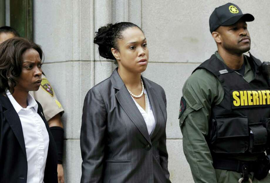 Baltimore state's attorney Marilyn Mosby, center, leaves a courthouse after Officer Caesar Goodson, one of six Baltimore city police officers charged in connection to the death of Freddie Gray, was acquitted of all charges in his trial in Baltimore on Thursday, June 23, 2016. Photo: AP Photo/Patrick Semansky  / Copyright 2016 The Associated Press. All rights reserved. This material may not be published, broadcast, rewritten or redistribu