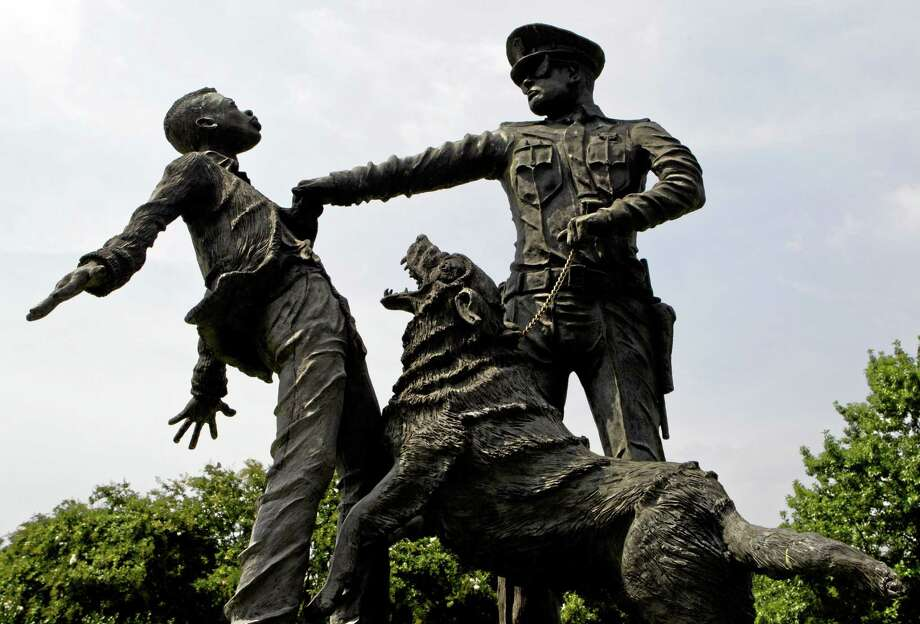 A young protester confronted by a police officer and a snarling police dog is depicted in a sculpture in Kelly Ingram Park in Birmingham, Ala. Photo: File Photo  / FR111446 AP